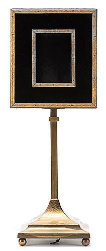 Card Restoration Frame. New York: Theo Bamberg, ca. 1909. Unusual and early apparatus allows for the gradual appearance of a card, one small piece at a time, in the center of a gilt wood frame trimmed with black fabric. Operates with an unusual