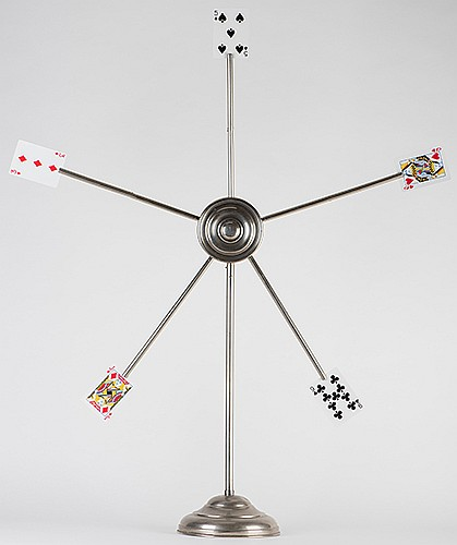 Card Star. Hamburg: Carl Willmann, ca. 1900. Five selected cards appear on the points of a metal star at the command of the magician. Nickel-plated tabletop model, 33î high. Base, center, and arms detach for packing. Minor wear and one unobtrusive