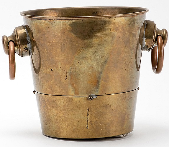 Coin Pail. Chicago: Roterberg [?], ca. 1912. Brass champagne bucket that facilitates the magic trick known as the MiserÍs Dream, in which the performer plucks a seemingly endless quantity of silver coins from thin air. Special pail conceals one