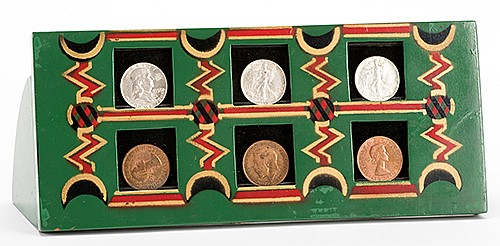 T.J. CrawfordÍs Coin Rack. Colon: AbbottÍs Magic Novelty Co., ca. 1937. Wooden rack with spaces for six coins facilitates the vanish of the money with the ñtouch of one finger,î as claimed catalog advertisements. Lacquered in four colors. 11 _î