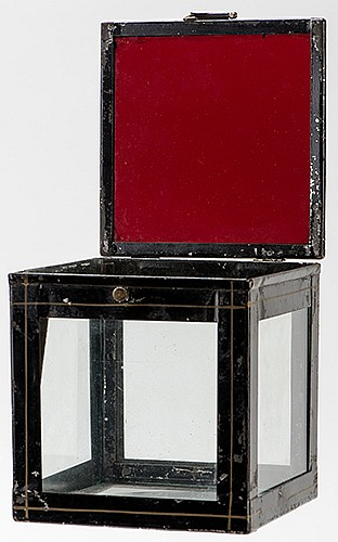 Crystal Casket. European, ca. 1880. A quantity of silk handkerchiefs of other objects appear in the glass-sided box at the magicianÍs command. Upper panel of red tinted glass. 4î cube. Paint worn; good.