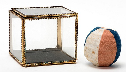 Crystal Casket. German [?], first quarter twentieth century. A small clear glass case, with decorative brass trim and inner cloth surface, instantly fills with handkerchiefs or other objects. 4î cube. With an antique multicolored spring ball.