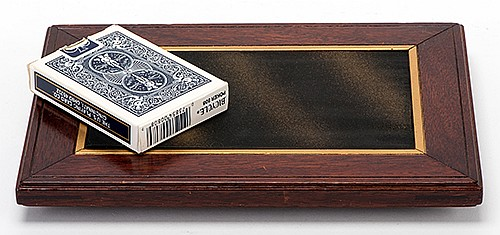 Deck Switching Tray. Los Angeles: F.G. Thayer, ca. 1925. An apparently innocent mahogany tray allows the magician to secretly switch one deck for another. 7 x 9 _î.