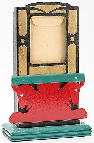 DevilÍs Mail Box/DevilÍs Card Rise. Los Angeles: F.G. Thayer & Co., ca. 1944. A lacquered picture frame on an elaborate base allows the performer to visibly yet secretly switch one envelope for another when placing an envelope in the frame. 6 _ x 9