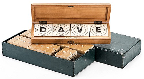 Alphabet Divination. Circa 1900. Four blocks with letters of the alphabet _ which may be formed into a word of the spectatorÍs choosing _ are locked in a handsome oblong hardwood box. The magician instantly divines the word or letters inside.