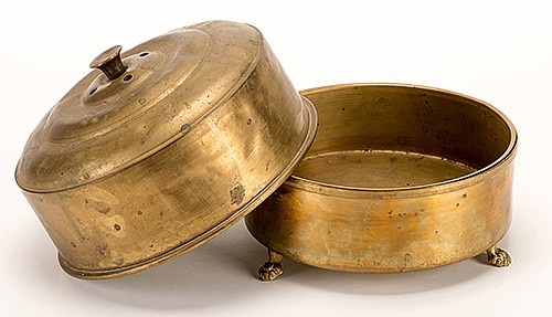 MagicianÍs Chafing Dish (Dove Pan). American, ca. 1900. Brass pan with claw feet. Early example of this classic prop that transforms liquid ingredients into live doves or anything else that fits inside. Lid 8 _î diameter. Visible wear and dents.