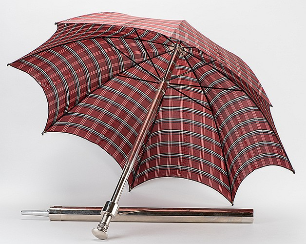 Mutilated Parasol. French, ca. 1930. The tartan cover of a parasol and separate silk handkerchiefs magically transpose. Includes duplicate cover, nickel plated tube, and parasol. Substantial construction. An outstanding and unusual example of this