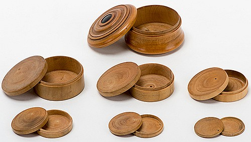 Nest of Boxes. English [?], ca. 1890. Fine set of seven lathe-turned wooden boxes. A coin vanishes, only to reappear in the smallest of the containers. Smallest box holds an American nickel. Largest box 2 _î diameter. Fine.