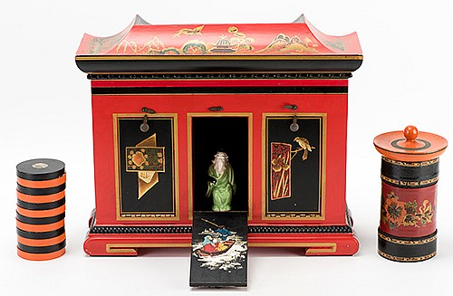 Okito Checker Cabinet. Chicago: Okito (Theodore Tobias Bamberg), ca. 1948. Complete club-size model of the cabinet, decorated in Chinese style, with original checkers and tube, for the transposition of a stack of checkers and a glass full of rice or