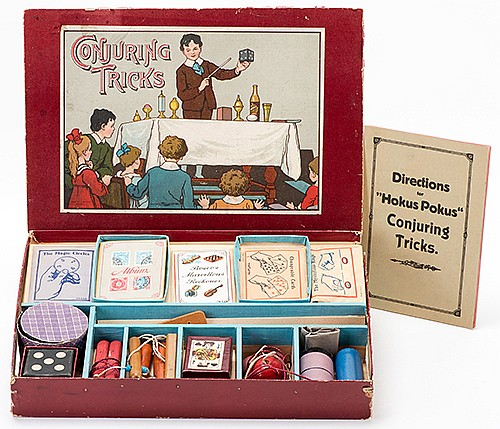 Conjuring Tricks Magic Set. Bavaria: J.W. Spear & Sons, ca. 1945. Handsome set contains wooden and paper props, including a Die Through Hat, paddle trick, magic awl, Pillars of Solomon, miniature stamp album, flap card box, Marble Vase, and more.