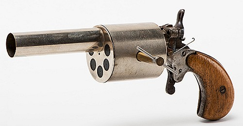 Silk Pistol. Hamburg: Conradi, ca. 1920 [?]. A handkerchief draped over the barrel of the gun vanishes when the trigger is pulled. Wooden handle, plated brass mechanism. 7 _î long. With original key. Good.