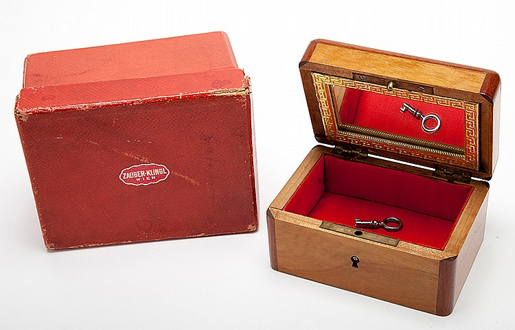 Ticking Watch Box. Vienna: R. Klingl, ca. 1900. A borrowed watch is placed into a small mahogany box, lined with felt and with a gilt-framed mirror in its lid. The box is locked and covered it with a handkerchief. As the performance continues the box