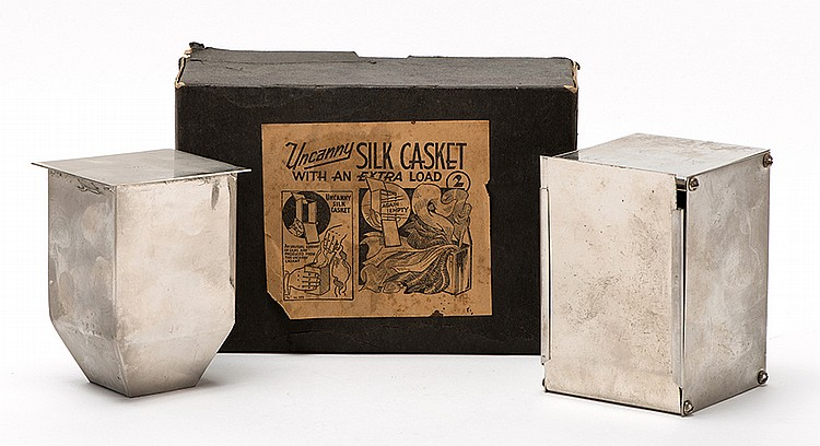 Uncanny Silk Casket. Bridgeport: Sherms, ca. 1940. A nickel-plated box is shown empty, but a moment later, a quantity of silks is produced from inside. With an extra load chamber as issued, in the manufacturerÍs labeled box with instructions.