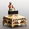 Little Turkish Conjurer Musical Automaton. Swiss, first half nineteenth century. An exceptional diminutive musical automaton in the form of a small bearded Turkish man standing behind a cloth-covered table on four legs. As the music box plays, he
