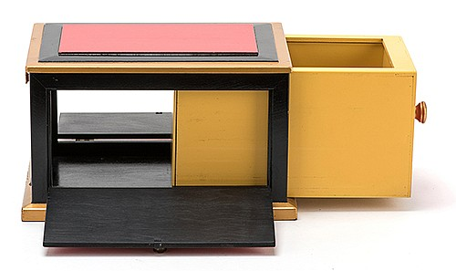 Sesame Drawer Box. Asuza: Owen Magic Supreme, ca. 1975. Large drawer is shown empty, closed, and when re-opened, is filled to the brim. Sides and rear of box that hold the drawer can be opened to allow spectators to look through it. Good.