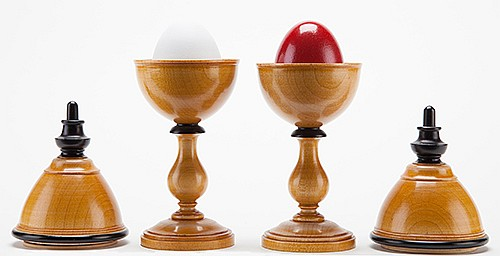 Passe Passe Egg Vases. Lake Forest, Ill.: John McKinven, ca. 1995. Hand-turned pair of hardwood and ebony mechanical vases, used in the transposition of red and white eggs as the lids are lifted and replaced. Hallmarked. 7 _î tall. Fine.