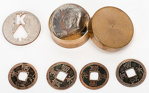 SawaÍs Coin Box. Japan: Rabbit Co., 1970s. Number 33 from an unknown limitation, engraved on the underside. Specially-prepared brass coin box and six gimmicked coins, housed in a velvet case, with original lecture notes signed by Dr. Sawa. Scarce.