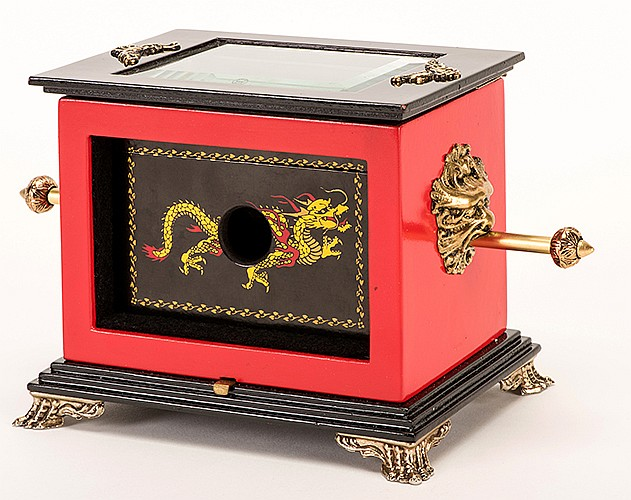 Temple of Dragons and Jewel Chest of Sea Ling. Arizona: Richard Gerlitz, ca. 2000. A wooden jewel chest filled with baubles is locked into an open cabinet with crystal clear top by running a solid brass bar through it. The chest then visibly vanishes