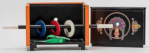 Ring on Wand Illusion. Pasadena: Okito-Williams, ca. 1995. Solid wooden rings penetrate a magic wand when placed inside an open-topped cabinet. Elaborately decorated with orange lacquer and decals, in the style of Okito. One of 50 units manufactured.