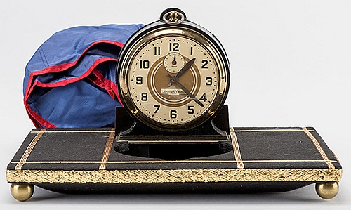 Vanishing Alarm Clock. Akron: H. Marshall & Co., ca. 1970. A ringing clock covered by a cloth is lifted from a tray. A final glimpse of the clock is given, then the cloth is thrown in the air; the clock has vanished. Tray 14 x 10 _î.