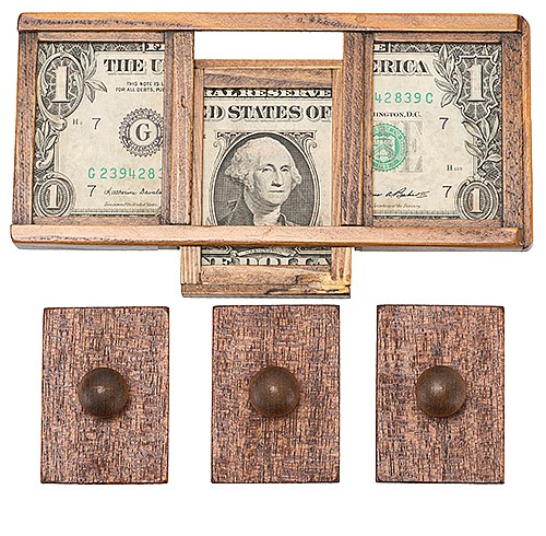 Zig Zag Dollar Bill. Robert Jackson for Sterling Magic, ca. 1986. A bill placed in a wooden framework is trisected visibly, then restored and removed from the frame unharmed. 6 _î long.