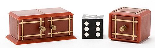 Die Box and Drawer Box. Holland: Eddy Taytelbaum, 1970s. Mitered miniature plastic boxes with gilt inlays and brass knobs, and black dice. A black die vanishes from the larger box and appears in the drawer, which had been previously shown empty. 2 _