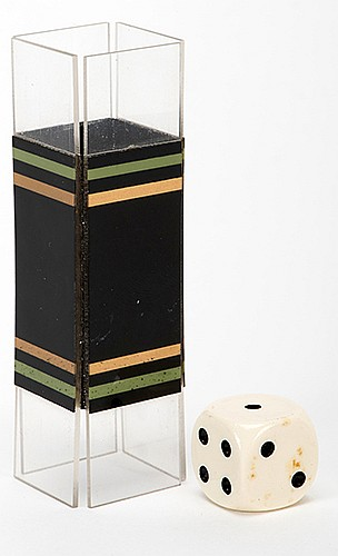 Die Tunnel. Holland: Eddy Taytelbaum, 1970s. Collapsible laminated tube with clear plastic ends, and a die. When passed through the tube, the numbers on the die change position. Tube 2 _î long.