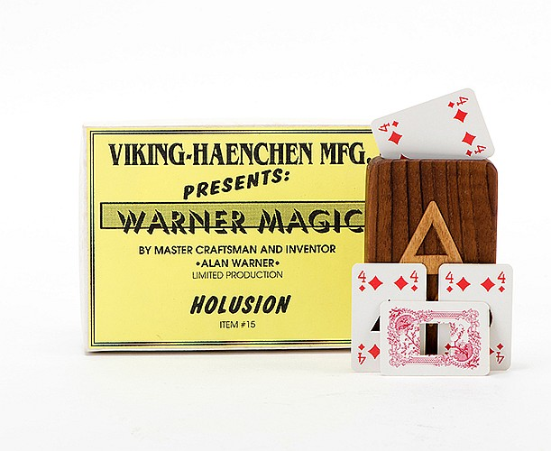 Holusion. Middlesex: Alan Warner, ca. 1990. A patience-sized playing card is placed in a teakwood case. In succession, the card is pierced at its center in square, triangular, and circular shapes. Finally it is restored to its original condition.