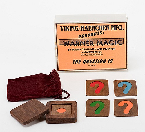 The Question Is. Middlesex: Alan Warner, ca. 1990. The color of one of several tiles freely chosen by a spectator matches that which the magician reveals in the small covered teakwood box. With original box, velvet carrying bag, and instructions.