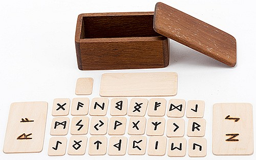Runic. Middlesex: Alan Warner, ca. 1990. Two Viking runic symbols, chosen freely by a spectator, ñburnî themselves into the previously blank wooden plaques resting on the table. Teakwood construction. With original box and instructions. Fine.