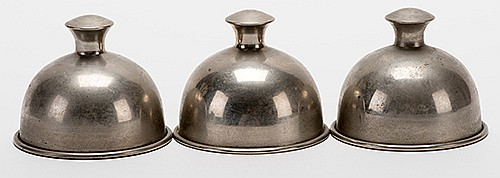 Raymond, Maurice (Morris Raymond Saunders). Indian Cups. Circa 1910. Set of three spun metal cups of ñIndianî design with knobs at their tops for the traditional Cups and Balls trick. Nickel-plated copper. Mouths 2 _î across. From the collection