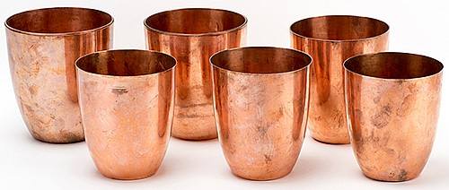 Raymond, Maurice (Morris Raymond Saunders). Germain Water Jars. Circa 1909. Handsome, large, and heavy spun copper jars. Each jar is shown empty, but a moment later, is filled to the brim with differently-colored shades of liquid. Eleven jars in all,