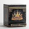 [Okito (Theodore Tobias Bamberg)]. Jack in the Box, or The Learned Judge. Circa 1909. A handsome wooden chest decorated with Asian-themed decals is shown to be filled with dried tea leaves. The lid is clamped on. Now a spectator in the magicianÍs