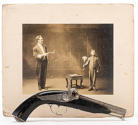 Raymond, Maurice (Morris Raymond Saunders). The Great RaymondÍs Stage Pistol. Circa 1910. Handsome filigreed muzzle-loading pistol owned and used by The Great Raymond in his stage performances. Sold together with a sepia-toned image in boudoir-card