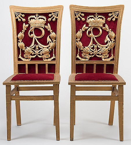 Raymond, Maurice (Morris Raymond Saunders). Raymond Production Chairs. Sturdy wooden chairs with folding legs painted in gilt with red plush backs, RaymondÍs initial logo carved in deep relief and set into the back of each chair. Each chair