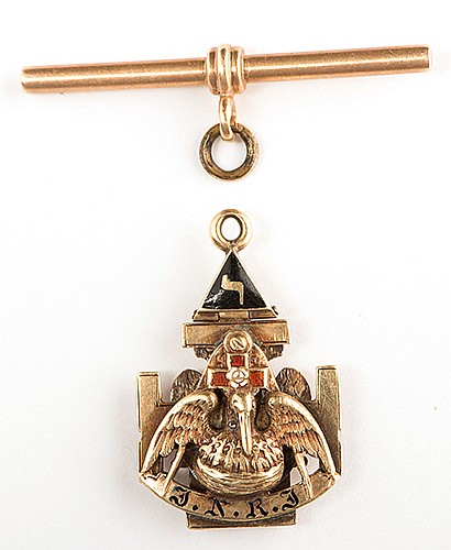 RaymondÍs Scottish Masonic Rite Pendant and Watch Fob T-Bar. First quarter twentieth century. A 14-karat 32nd degree Freemasonry presentation pendant attained by The Great Raymond, layered construction incorporating a double-headed eagle, pelican,