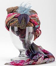 Turban of a MagicianÍs Assistant. Manufacturer unknown, first or second quarter twentieth century. A colorful vintage silk turban incorporating a decorative rhinestone-studded piece at the forefront, with birdÍs feathers tucked behind it. Likely to