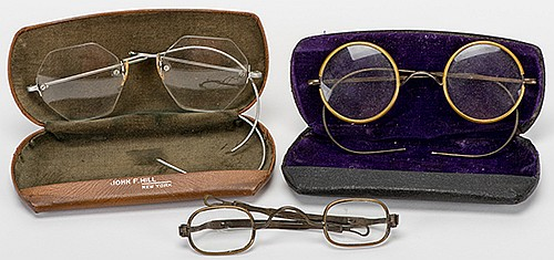 RaymondÍs Spectacles. American and European, early twentieth century. Three pairs of antique eyeglasses from the personal belongings of The Great Raymond. With brass and wire frames, two in velvet-lined hard cases stamped by the manufacturers (John