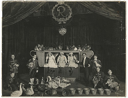 Raymond, Maurice F. (Morris Raymond Saunders). NoahÍs Ark Illusion Lobby Photo. Chicago: Kaufmann, Weiner & Fabry Co., ca. 1915. Silver gelatin print depicting Raymond and his assistants on a stage overflowing with livestock. 10 x 14 _î. Minor