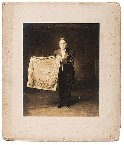 Raymond, Maurice F. (Morris Raymond Saunders). Series of Four Dramatic Portraits of RaymondÍs Magic Show. Fall River: Gay, ca. 1910. Sepia-tone prints depicting Raymond in the performance of various conjuring feats involving silks, a bird, and a