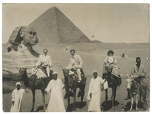 Raymond, Maurice F. (Morris Raymond Saunders). Photograph of Raymond at the Sphinx. Egypt, ca. 1911. Depicting the magician on camelback, accompanied by companions and guides, the Sphinx and a pyramid looming in the background. 6 _ x 9 _î.