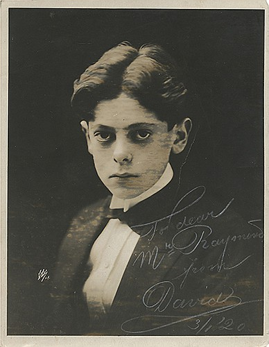 Bamberg, David. Adolescent Portrait Inscribed and Signed to The Great Raymond. New York, ca. 1920. Bust silver print portrait of the young performer staring intently at the viewer. 9 _ x 7 _î. Inscribed and signed in the lower right corner in white,