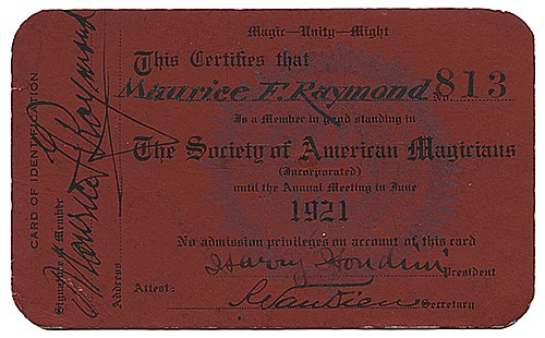 [Houdini, Harry (Ehrich Weiss)]. The Great RaymondÍs S.A.M. Membership Card, Signed by Harry Houdini and Raymond. New York, 1921. Red card stock printed with the Society of American Magicians seal, stamped number 813, certifying Maurice F. Raymond