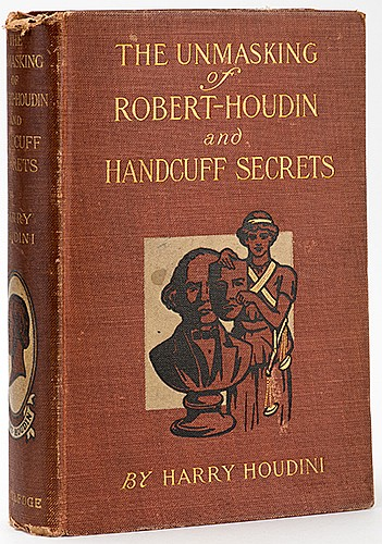 Houdini, Harry (Ehrich Weiss). The Unmasking of Robert-Houdin and Handcuff Secrets. London: George Routledge, 1909. PublisherÍs gilt-stamped pictorial cloth. Portrait frontispiece of Houdini. Illustrated. 8vo. Binding shaken, cloth mildly worn,