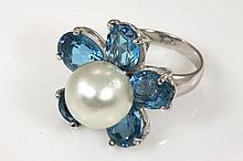 Pearl and Topaz ring with South Sea Pearl of 11.9mm and 5 Oval Blue Topaz totalling approximately 5 cts. 18ct white gold, ring size L.