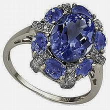 Beautiful Tanzanite Ring Surrounded by Sixteen Round Cut Diamonds Set in 10kt White Gold