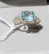 10kt Gold Ring With 4.45ct Swiss Blue Topaz Surrounded by 28 1/4 Carat Diamonds
