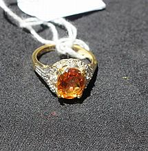 Diamond And Citrine Ring Totalling 22 Round Cut Diamonds