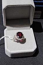 Garnet And Diamond Oval Cut Ring Garnet Surrounded by 12 Cut Diamonds