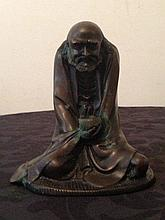Chinese Bronze Of A Figure Holding Cup